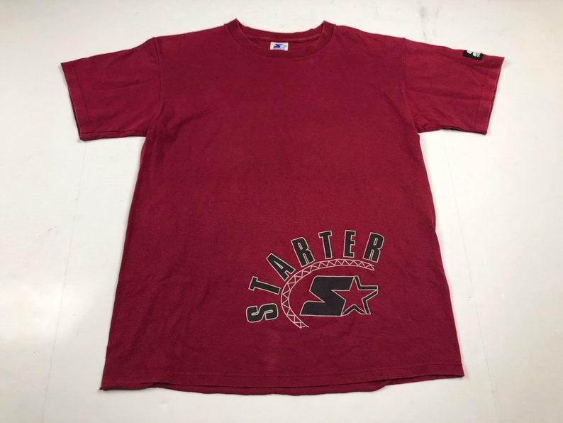 efccfa63c10 Vintage 90s Starter brand logo t-shirt youth L fits mens S