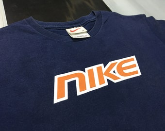 b94f99c1 Vintage Nike shirt spell out logo Navy Blue Size M Good condition Made in  usa
