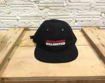 1e6df48a048 Vintage Marlboro cap spell out Marlboro unlimited embroidered logo  adjustable strapback cap Black Free size Excellent condition