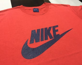 97b0b2bc Vintage Nike shirt 80s Nike swoosh logo spell out Red Navy Blue Size L  Excellent Single stitch Made in usa 80s Nike blue tag