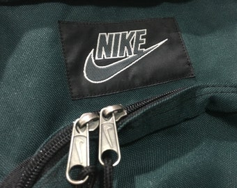 db0773d88 Vintage Nike backpack suede bottom Nike swoosh logo spell out Forrest Green  Brown Good condition 90s Nike bag
