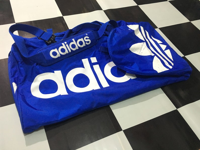 huge selection of 16c39 88ccd Vintage Adidas duffel Bag giant gym bag spell out big logo   Etsy