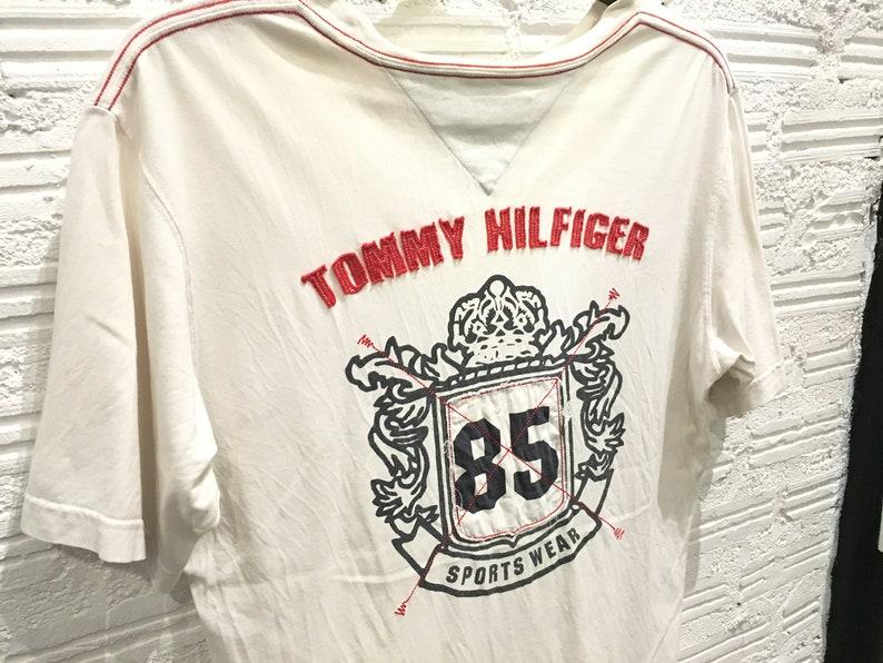 b15031ad Vintage Tommy hilfiger t shirt big logo spell out flag logo | Etsy
