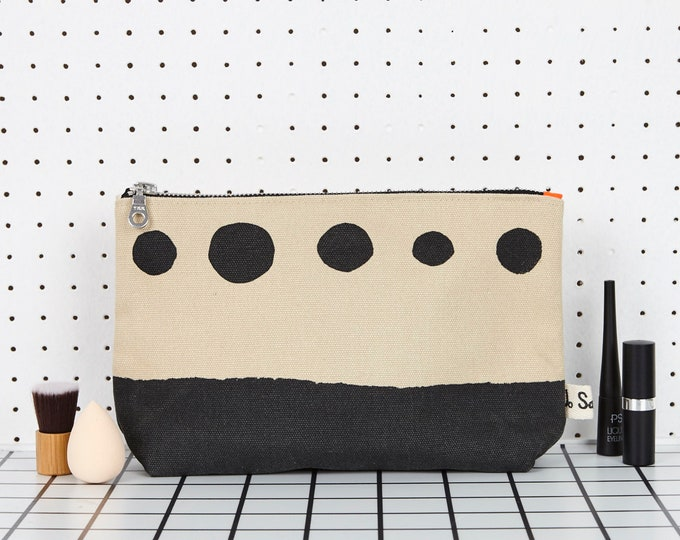 "Makeup Bag with black ""Scenic"" print."