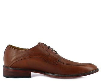 Men's dress shoe with wine midsole and lateral reinforcement.