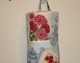 Plastic bag holder, grocery bag holder, bag holder/storage, bag dispenser.