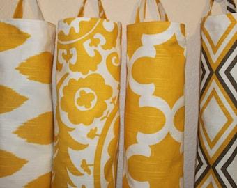 Plastic bag holders, grocery bag holders, bag dispensers yellow, white.