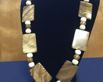 Gold tone stone necklace