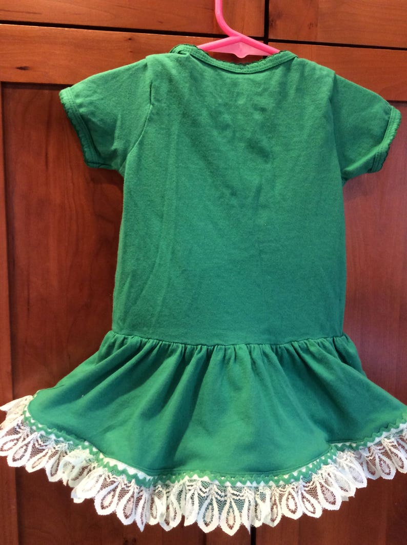 Notre Dame Baby onzie whit Notre Dame logo and snap saddle with additional lace and rick rack added