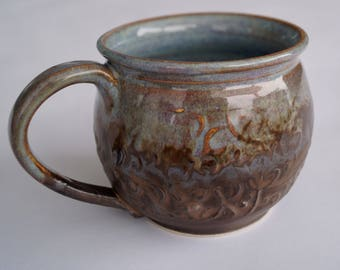 Cup of ceramics with elaborate pattern and glaze