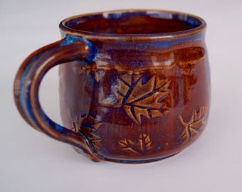 Small cup of ceramics with ornament.
