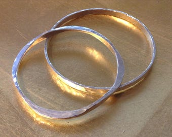 Hand made, hammered sterling silver bracelet and ring.