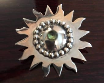 Silver sunflower pin with gemstone