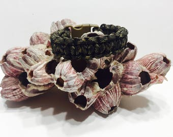 550 Paracord camo pattern with black, olive drab, tan, and brown called ground war bracelet