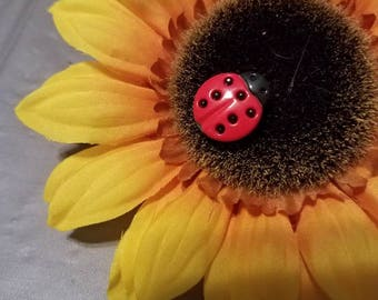 Large sunflower hairclip with lady bug