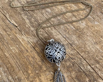 Boho round ball pendant in matte silver with vintage gold colored chain & complimentary tassel