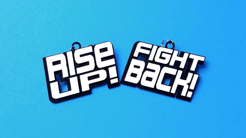 Rise Up Fight Back Statement Earrings In Multiple Color Black/White