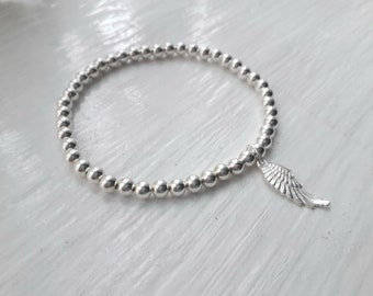 Sterling silver beaded stretch bracelet with Angel wing charm.