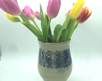 Handmade ceramic vase with lace imprints