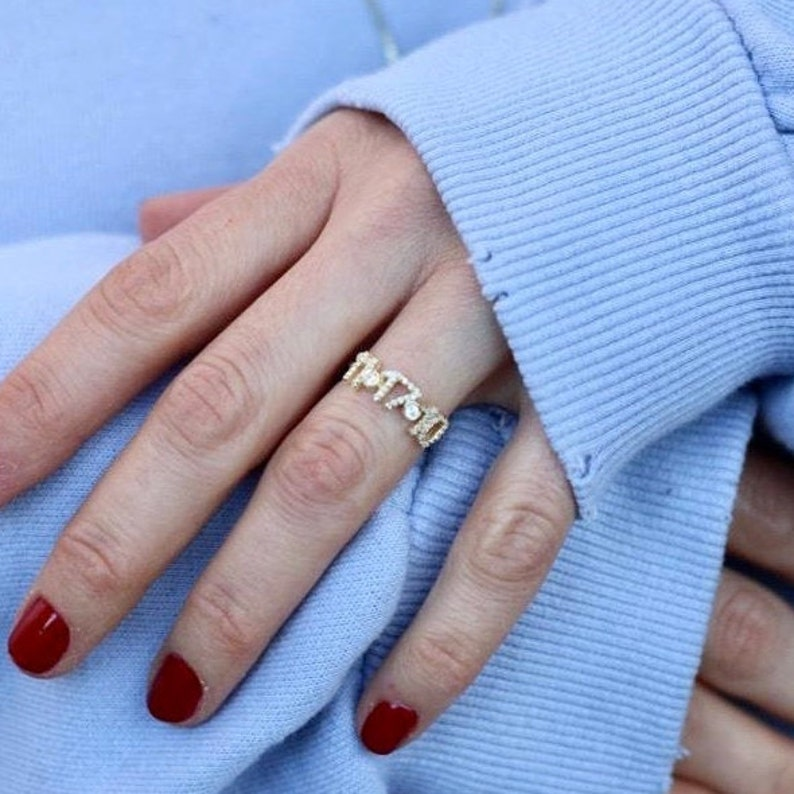 What is her favorite number? What is her important day? Buy her a personalized number ring and customize it with her favorite number. Help her to remind her important day and this gift will help you remind her of you.
