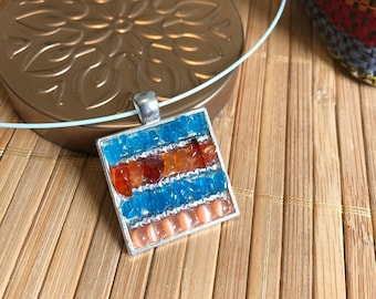 Pendant in natural stones, mini mosaic of fine stones and glass beads polished in the fire