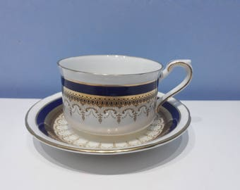 A vintage Paragon Stirling teacup and saucer in cobalt blue and gold made in England from fine bone china