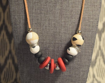 red polymer clay and handprinted wood bead necklace