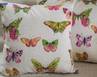 """Handmade Butterfly Cushion Cover. 17"""" x 17"""" square cushion cover with multicoloured butterflies in pinks, greens, on a linen-style cloth"""