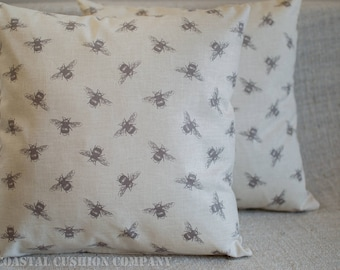 """Bumblebee Cushion. 17"""" x 17"""" vintage style pillow cover with buzzy bee print on a linen style background. Handmade, 100% Cotton."""