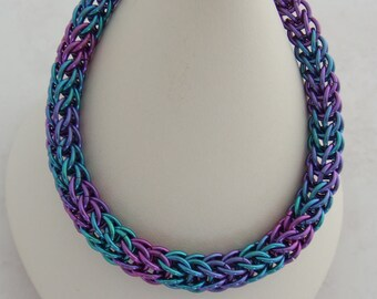 Full persian chainmaille weave bracelet made from anodized niobium jump rings in lavender, sky blue and rose with purple lobster clasp