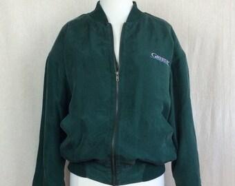 f32c54be7ed121 Vintage Silk Bomber Jacket    1994 MCA Universal Studios