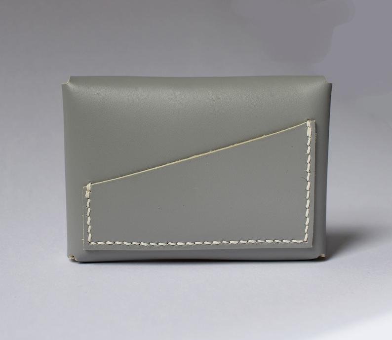 Door LUTI currency  Grey leather