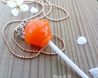 Orange resin lollipop necklace translucent