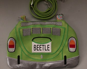 Size is roughly 6x8 Bag is fully lined VW Orange Beetle Bug  Cross body zipper bag with orange leather strap