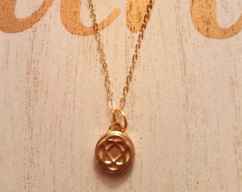 14kt gold 18inch chain with gold plated U Matter symbol .