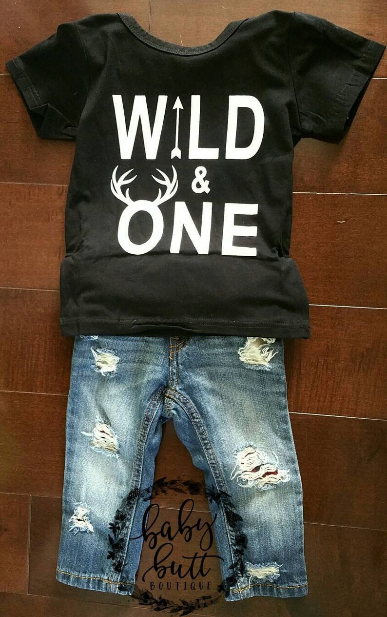 Wild one buffalo plaid distressed patched jeans outfit for country boy first birthday.Wild one red plaid first birthday photo outfit.