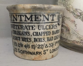 Holloway's ointment pot .