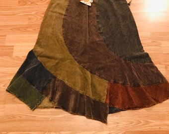 fdf47d9597 Vintage Sacred Threads corduroy skirt with an awesome patchwork design.  Great piece in a size XL and has a drawstring waist.