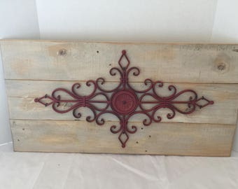 Red Scroll Wrought Iron Wall Art on Reclaimed Wood