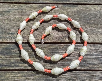 Handmade necklace with beige recycled paper and orange glass beads