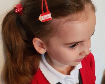 Single name hair clip for school.