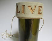 """Upcycled Minimalist """"Live"""" Wine Bottle Concrete Gold Rope Hanging Planter: Self-Watering"""