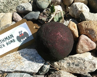 Black Mothman Bath bomb (2.75 Inch, 8 oz.) with Red Glitter with shea butter, mica powder - Scent: Violet, Pomegranate, Sandalwood