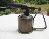 A Rare Vintage French Brass 1 4 Pint Petrol Blowlamp Blow Torch Stamped M L Paris With Large Military Gun On The Front