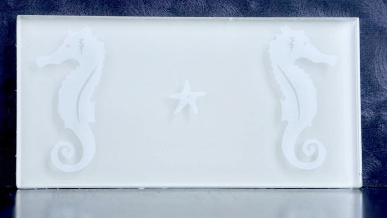 Glass subway tile with etched seahorses image 0
