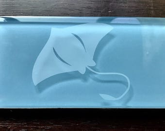 Glass subway tile with etched manta ray