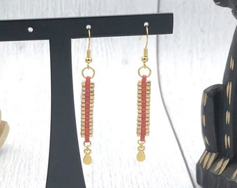 Red cubes, iridescent and gold earrings
