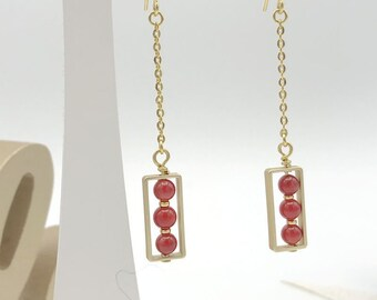 Red and gold gemstone earrings