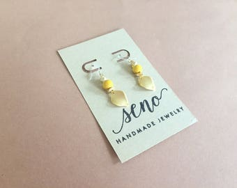 Gold/yellow leaf earrings, gold filled hooks, plastic hooks available.