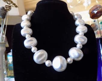 Nice vintage chunky faux pearl necklace with a little bit of a light gray tint.
